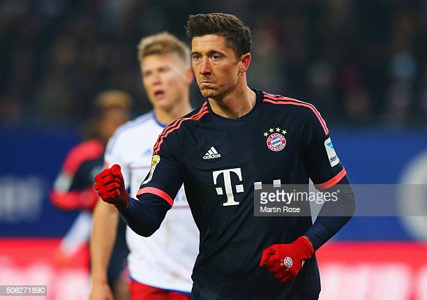 Robert Lewandowski of Bayern Munich celebrates as he scores their first goal from the penalty spot during the Bundesliga match between Hamburger SV...