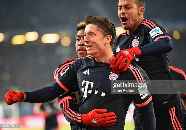Robert Lewandowski of Bayern Munich celebrates as he scores their second goal with Kingsley Coman and Thiago Alcantara during the Bundesliga match...