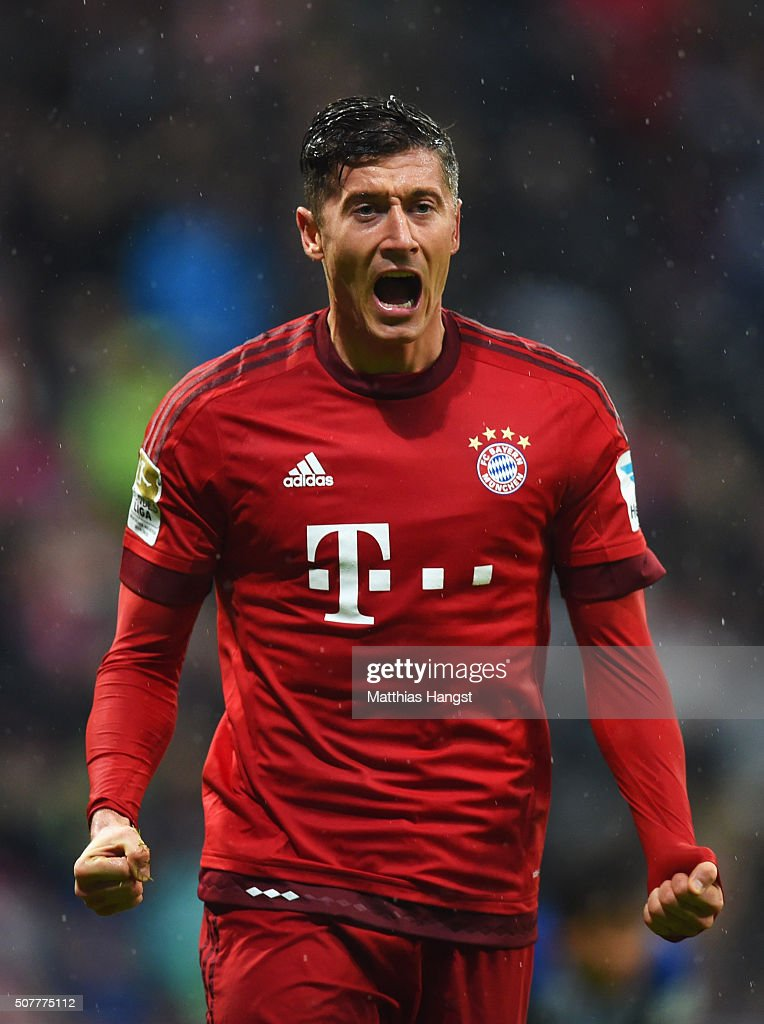 <a gi-track='captionPersonalityLinkClicked' href=/galleries/search?phrase=Robert+Lewandowski&family=editorial&specificpeople=5532633 ng-click='$event.stopPropagation()'>Robert Lewandowski</a> of Bayern Munich celebrates as he scores their first goal during the Bundesliga match between FC Bayern Muenchen and 1899 Hoffenheim at Allianz Arena on January 31, 2016 in Munich, Germany.