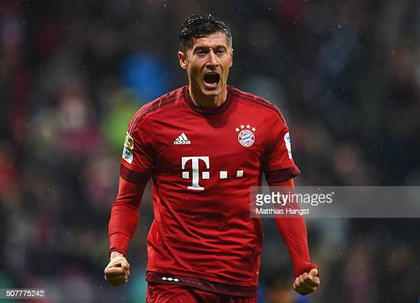 Robert Lewandowski of Bayern Munich celebrates as he scores their first goal during the Bundesliga match between FC Bayern Muenchen and 1899...