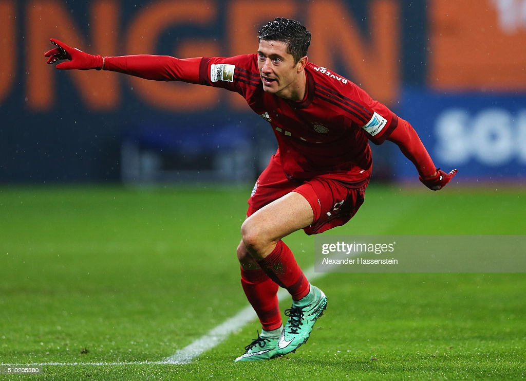 <a gi-track='captionPersonalityLinkClicked' href=/galleries/search?phrase=Robert+Lewandowski&family=editorial&specificpeople=5532633 ng-click='$event.stopPropagation()'>Robert Lewandowski</a> of Bayern Munich celebrates as he scores their second goal during the Bundesliga match between FC Augsburg and FC Bayern Muenchen at SGL Arena on February 14, 2016 in Augsburg, Germany.