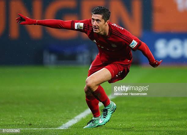 Robert Lewandowski of Bayern Munich celebrates as he scores their second goal during the Bundesliga match between FC Augsburg and FC Bayern Muenchen...