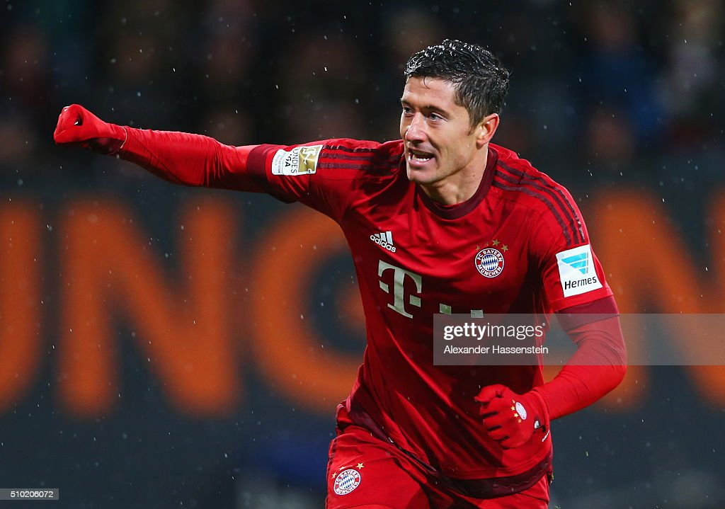Robert Lewandowski of Bayern Munich celebrates as he scores their second goal during the Bundesliga match between FC Augsburg and FC Bayern Muenchen...
