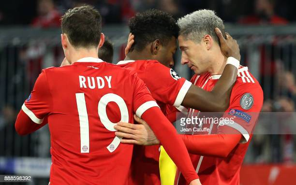 Robert Lewandowski of Bayern Munich celebrates his goal with David Alaba during the UEFA Champions League group B match between Bayern Muenchen and...