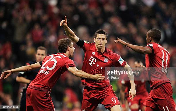 Robert Lewandowski of Bayern Munich celebrates scoring his 1st goal during the Bundesliga match between FC Bayern Muenchen and VfL Wolfsburg at...