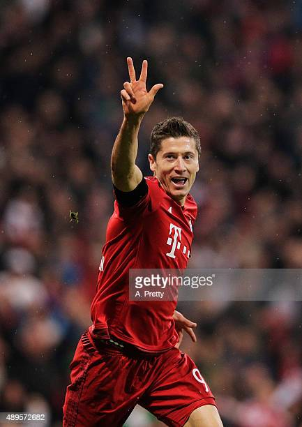 Robert Lewandowski of Bayern Munich celebrates scoring his 3rd goal during the Bundesliga match between FC Bayern Muenchen and VfL Wolfsburg at...