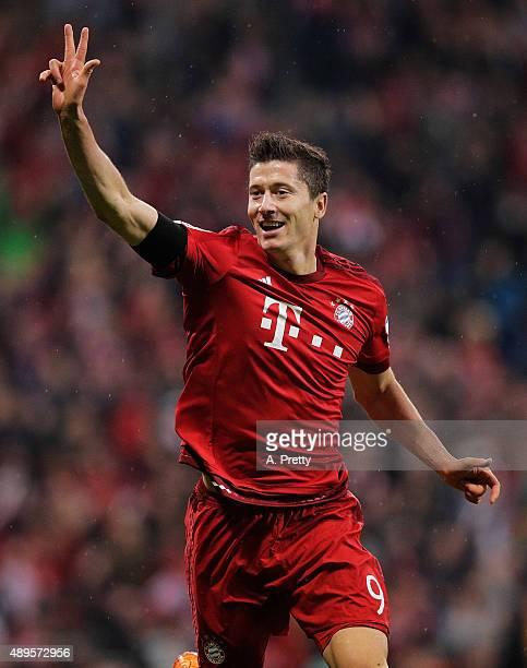 Robert Lewandowski of Bayern Munich celebrates scoring his 3rd goal during the Bundesliga match between FC Bayern Muenchen and VfL Wolfsburg at...
