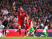 Robert Lewandowski of Bayern Munich celebrates scoring his 4th goal during the Bundesliga match between FC Bayern Muenchen and VfL Wolfsburg at...