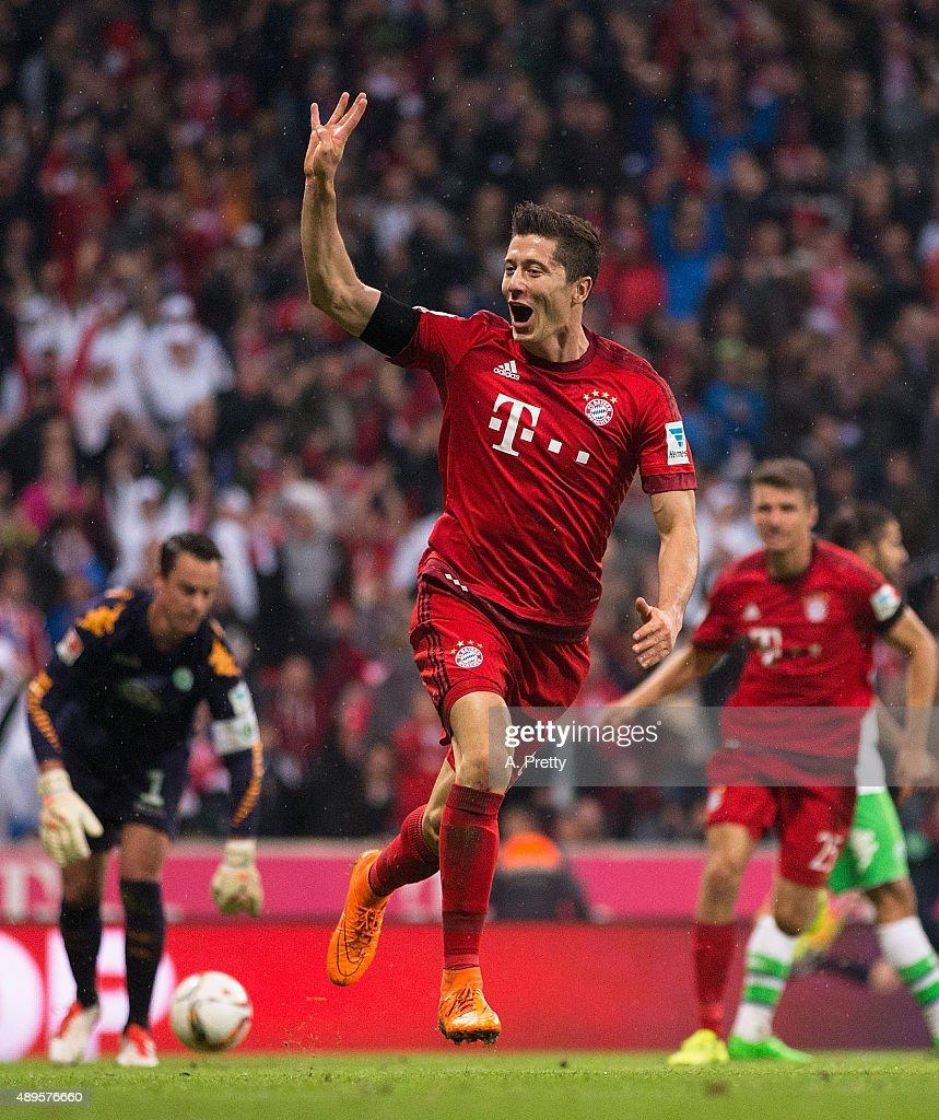Robert Lewandowski of Bayern Munich celebrates scoring his 4th goal during the Bundesliga match between FC Bayern Muenchen and VfL Wolfsburg at Allianz Arena on September 22, 2015 in Munich, Germany.