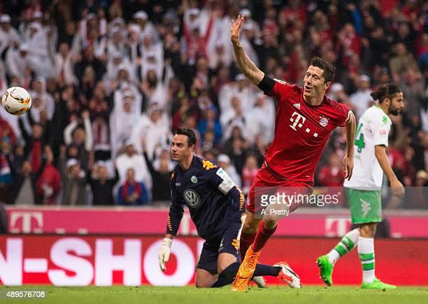 Robert Lewandowski of Bayern Munich celebrates scoring his 4th goal during the Bundesliga match between FC Bayern Muenchen and VfL Wolfsburg at...
