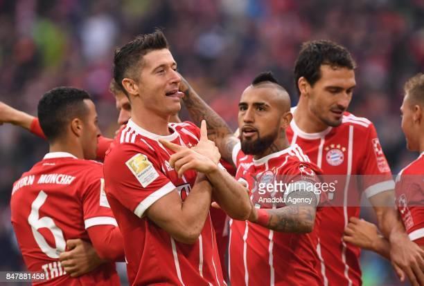 Robert Lewandowski of Bayern Munich celebrates with his team mates after scoring a goal during the Bundesliga soccer match between Bayern Munich and...
