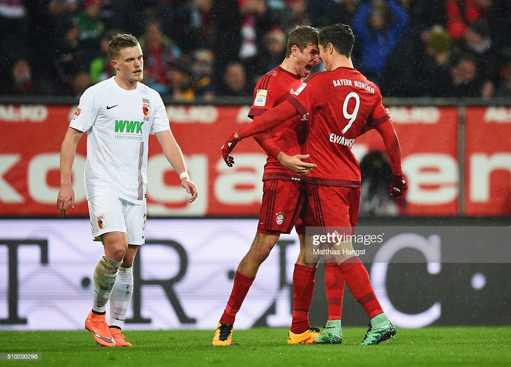 <a gi-track='captionPersonalityLinkClicked' href=/galleries/search?phrase=Robert+Lewandowski&family=editorial&specificpeople=5532633 ng-click='$event.stopPropagation()'>Robert Lewandowski</a> of Bayern Munich (9) celebrates with Thomas Mueller as he scores their first goal during the Bundesliga match between FC Augsburg and FC Bayern Muenchen at SGL Arena on February 14, 2016 in Augsburg, Germany.