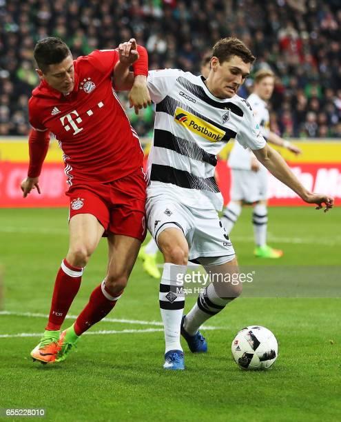 Robert Lewandowski of Bayern Munich challenges Andreas Christensen of Borussia Moenchengladbach during the Bundesliga match between Borussia...
