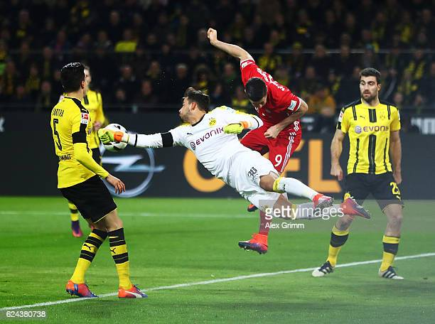 Robert Lewandowski of Bayern Munich colides with Roman Buerki of Borussia Dortmund during the Bundesliga match between Borussia Dortmund and Bayern...