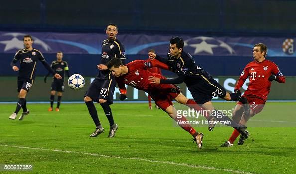 Robert Lewandowski of Bayern Munich holds of Leonardo Sigali of Dinamo Zagreb to score the first Bayern Munich goal during the UEFA Champions League...