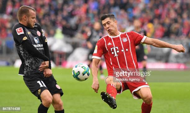 Robert Lewandowski of Bayern Munich in action against Daniel Brosinski of Mainz 05 during Bundesliga soccer match between Bayern Munich and Mainz 05...
