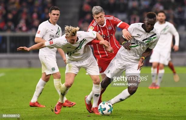 Robert Lewandowski of Bayern Munich in action against Felix Klaus and Salif Sane of Hannover during the Bundesliga soccer match between FC Bayern...