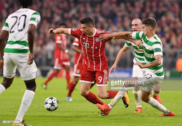 Robert Lewandowski of Bayern Munich in action against Mikael Lustig of Celtic FC during the Champions League group B soccer match between FC Bayern...