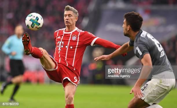 Robert Lewandowski of Bayern Munich in action against Rani Khedira of Augsburg during the Bundesliga soccer match between FC Bayern Munich and FC...