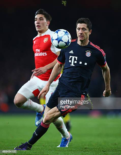 Robert Lewandowski of Bayern Munich is chased by Hector Bellerin of Arsenal during the UEFA Champions League Group F match between Arsenal FC and FC...