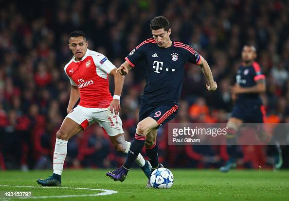 Robert Lewandowski of Bayern Munich is chased by SAlexis Sanchez of Arsenal during the UEFA Champions League Group F match between Arsenal FC and FC...