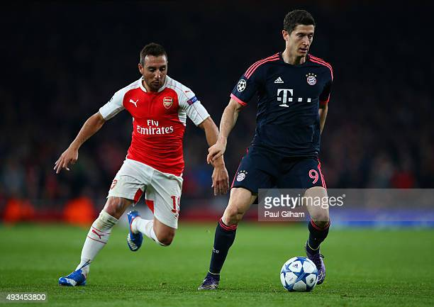 Robert Lewandowski of Bayern Munich is chased by Santi Cazorla of Arsenal during the UEFA Champions League Group F match between Arsenal FC and FC...