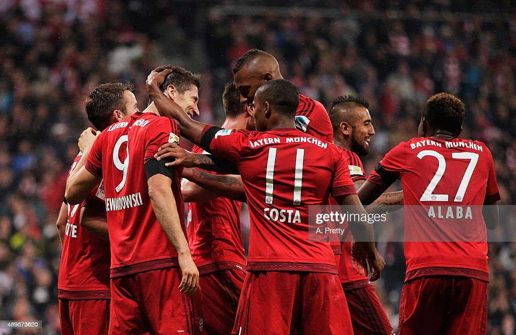 Robert Lewandowski of Bayern Munich is congratulated after scoring his 5th goal during the Bundesliga match between FC Bayern Muenchen and VfL Wolfsburg at Allianz Arena on September 22, 2015 in Munich, Germany.