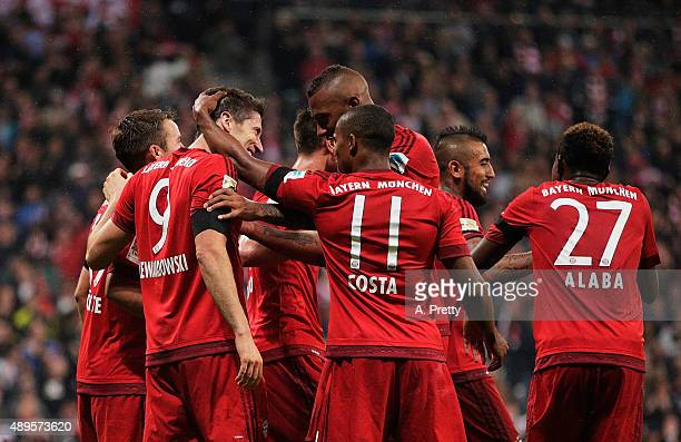 Robert Lewandowski of Bayern Munich is congratulated after scoring his 5th goal during the Bundesliga match between FC Bayern Muenchen and VfL...