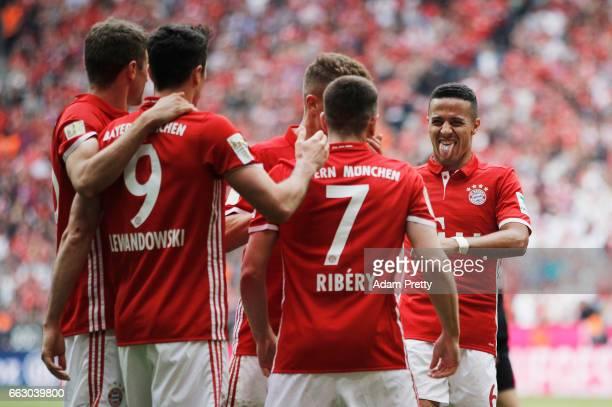 Robert Lewandowski of Bayern Munich is congratulated by Thiago Alcantara of Bayern Munich after scoring his second goal during the Bundesliga match...