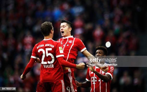 Robert Lewandowski of Bayern Munich is congratulated by Thomas Mueller after scoring a goal during the Bundesliga match between FC Bayern Muenchen...
