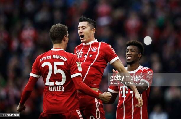 Robert Lewandowski of Bayern Munich is congratulated by Thomas Mueller after scoring a goal during the Bundesliga match between FC Bayern Muenchen...