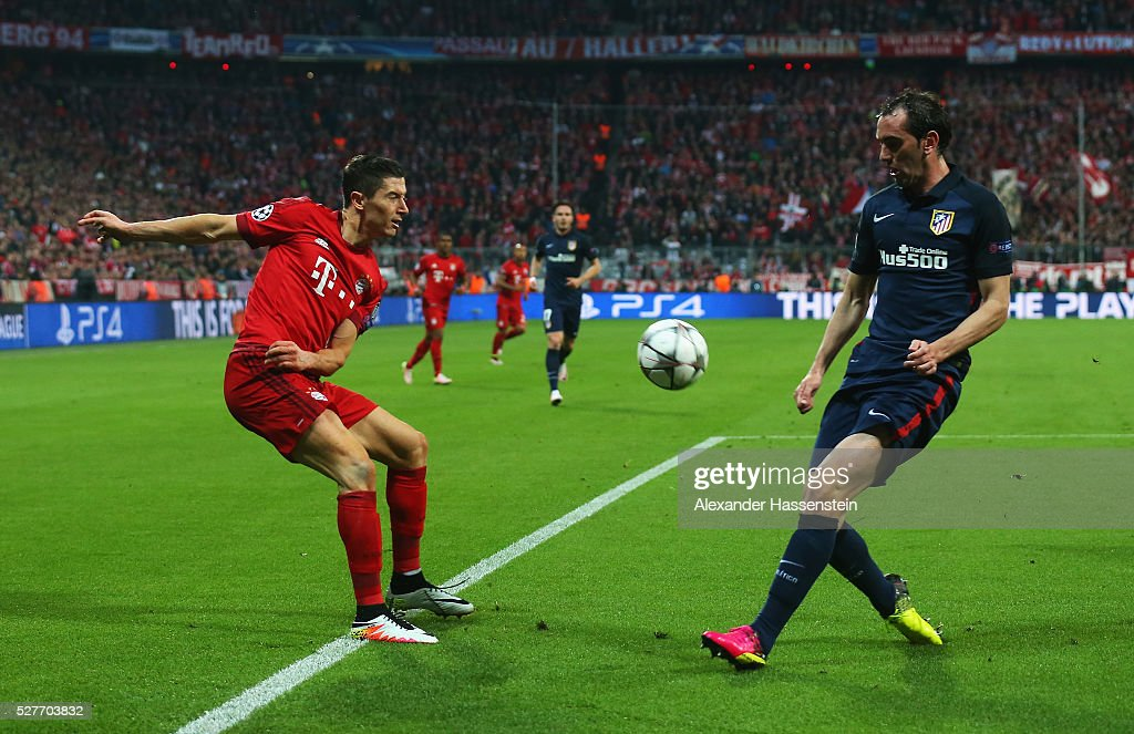 <a gi-track='captionPersonalityLinkClicked' href=/galleries/search?phrase=Robert+Lewandowski&family=editorial&specificpeople=5532633 ng-click='$event.stopPropagation()'>Robert Lewandowski</a> of Bayern Munich is faced by <a gi-track='captionPersonalityLinkClicked' href=/galleries/search?phrase=Diego+Godin&family=editorial&specificpeople=608999 ng-click='$event.stopPropagation()'>Diego Godin</a> of Atletico Madrid during UEFA Champions League semi final second leg match between FC Bayern Muenchen and Club Atletico de Madrid at Allianz Arena on May 3, 2016 in Munich, Germany.