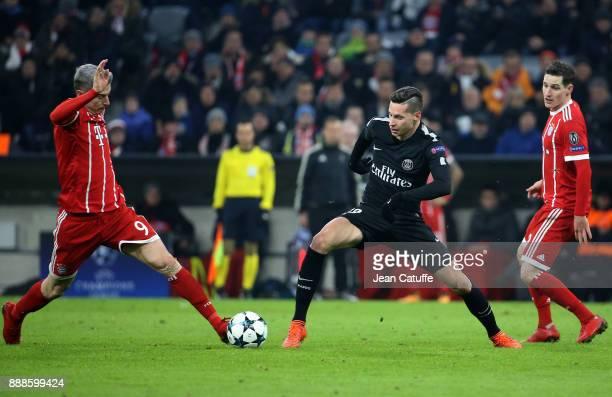Robert Lewandowski of Bayern Munich Julian Draxler of PSG Sebastian Rudy of Bayern Munich during the UEFA Champions League group B match between...