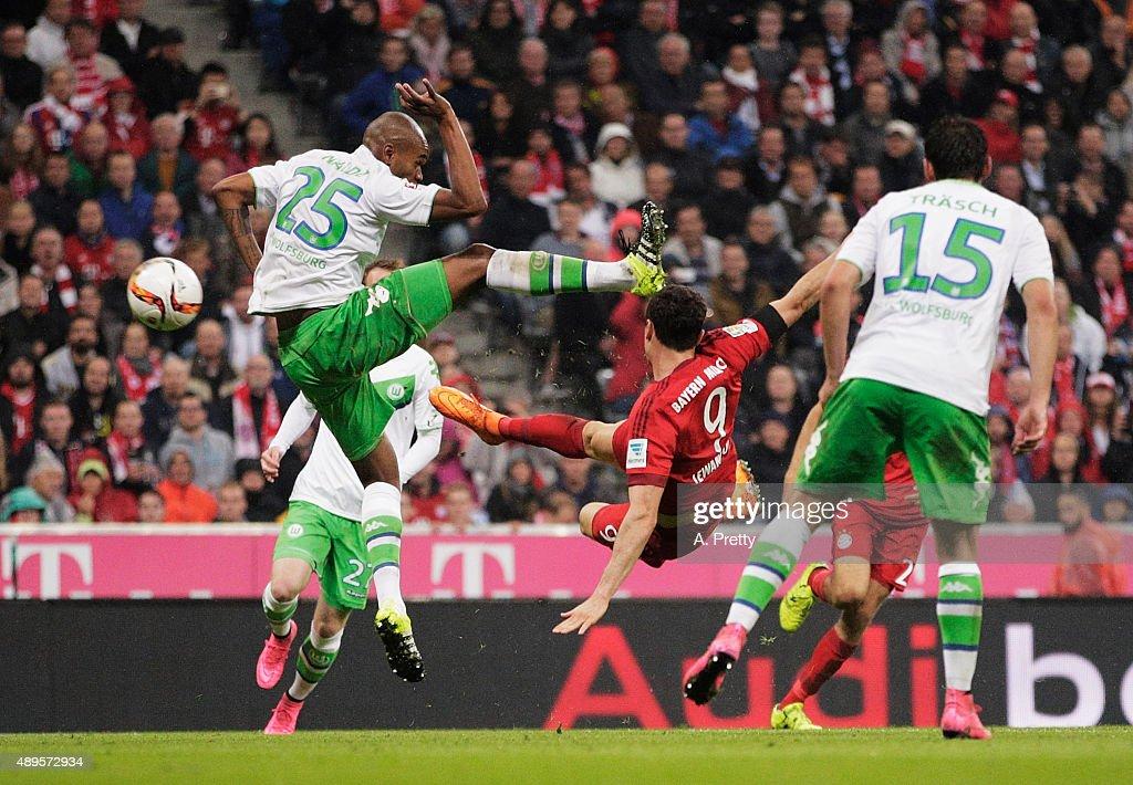 Robert Lewandowski of Bayern Munich scores his 5th goal during the Bundesliga match between FC Bayern Muenchen and VfL Wolfsburg at Allianz Arena on September 22, 2015 in Munich, Germany.