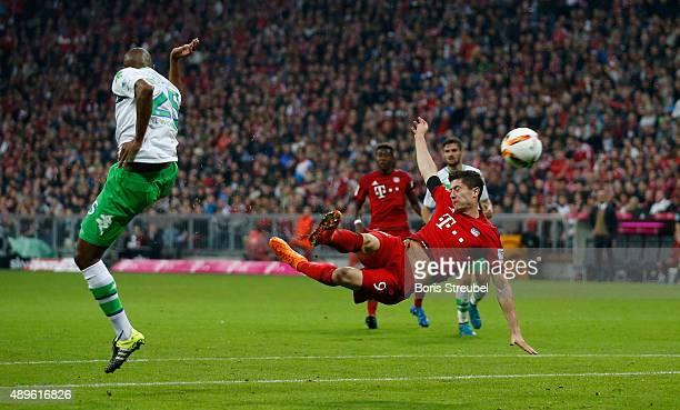 Robert Lewandowski of Bayern Munich scores his 5th goal with a sideways scissorkick during the Bundesliga match between FC Bayern Muenchen and VfL...