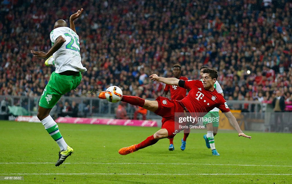 Robert Lewandowski of Bayern Munich scores his 5th goal with a sideways scissorkick during the Bundesliga match between FC Bayern Muenchen and VfL...