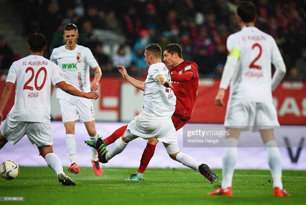 <a gi-track='captionPersonalityLinkClicked' href=/galleries/search?phrase=Robert+Lewandowski&family=editorial&specificpeople=5532633 ng-click='$event.stopPropagation()'>Robert Lewandowski</a> of Bayern Munich (2R) scores their first goal during the Bundesliga match between FC Augsburg and FC Bayern Muenchen at SGL Arena on February 14, 2016 in Augsburg, Germany.