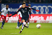Robert Lewandowski of Bayern Munich scores their first goal from the penalty spot during the Bundesliga match between Hamburger SV and FC Bayern...
