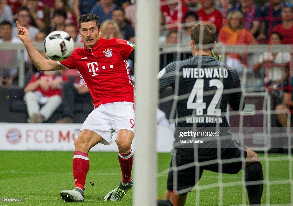 Robert Lewandowski of Bayern Munich scoring the second goal during the Bundesliga match between Bayern Muenchen and Werder Bremen at Allianz Arena on...