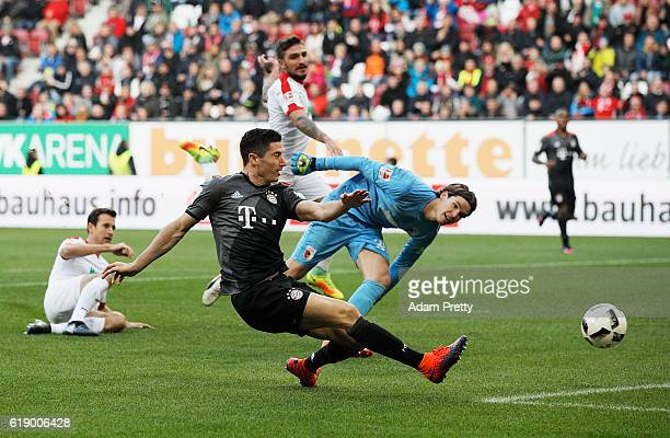 Robert Lewandowski of Bayern Munich scors the third goal during the Bundesliga match between FC Augsburg and Bayern Muenchen at WWK Arena on October...