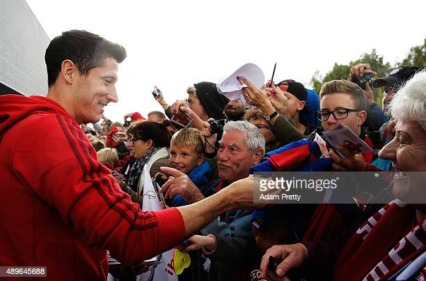 Robert Lewandowski of Bayern Munich signs autographs and poses for photos before the Audi Driving Experience and the Audi to FC Bayern Muenchen new...