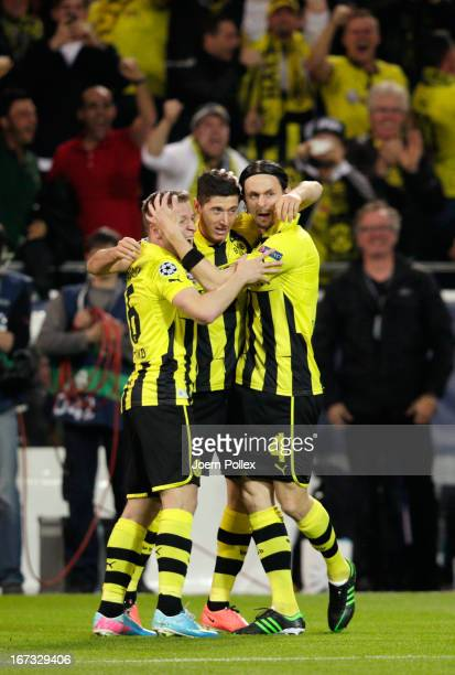 Robert Lewandowski of Borussia Dortmund celebrates scoring the opening goal with Sven Bender and Neven Subotic of Borussia Dortmund during the UEFA...