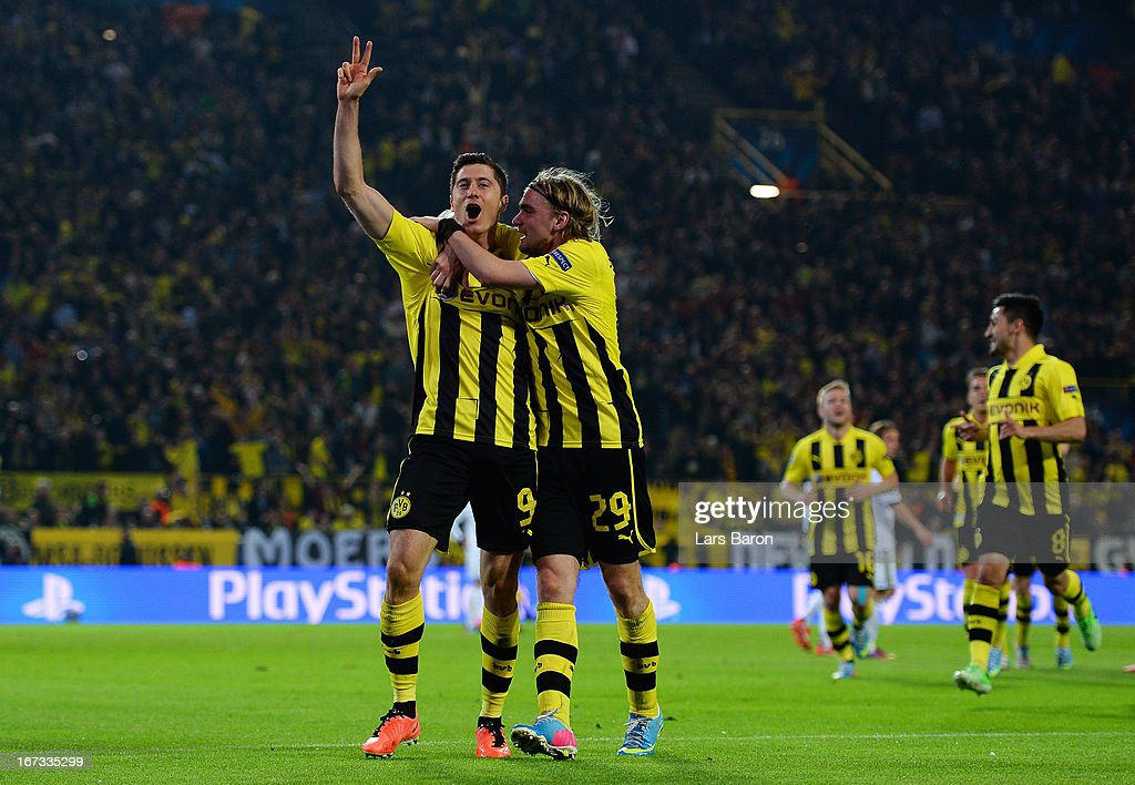 <a gi-track='captionPersonalityLinkClicked' href=/galleries/search?phrase=Robert+Lewandowski&family=editorial&specificpeople=5532633 ng-click='$event.stopPropagation()'>Robert Lewandowski</a> of Borussia Dortmund celebrates scoring their third goal and his hat-trick with team mate <a gi-track='captionPersonalityLinkClicked' href=/galleries/search?phrase=Marcel+Schmelzer&family=editorial&specificpeople=5443925 ng-click='$event.stopPropagation()'>Marcel Schmelzer</a> of Borussia Dortmund during the UEFA Champions League semi final first leg match between Borussia Dortmund and Real Madrid at Signal Iduna Park on April 24, 2013 in Dortmund, Germany.