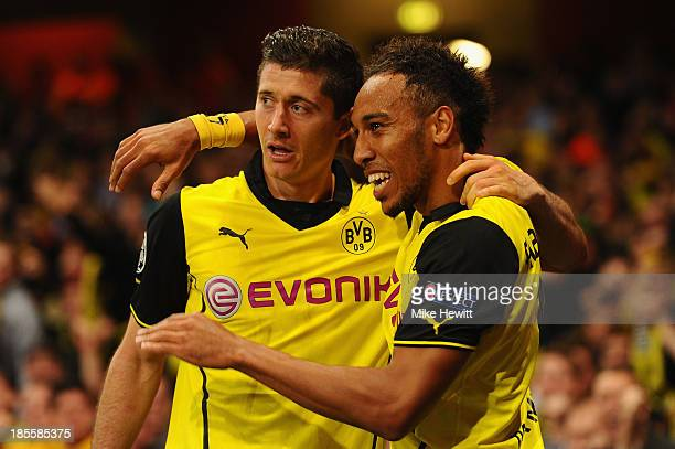 Robert Lewandowski of Borussia Dortmund celebrates scoring their second goal with PierreEmerick Aubameyang of Borussia Dortmund during the UEFA...
