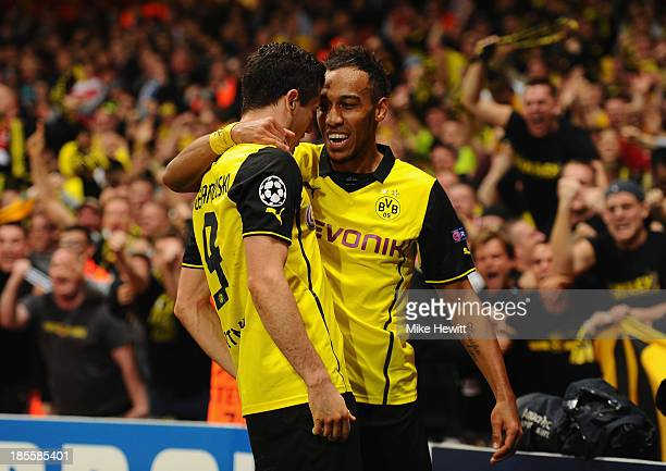 Robert Lewandowski of Borussia Dortmund celebrates scoring their second goal with PierreEmerick Aubameyang of Borussia Dortmund during the UEFA...