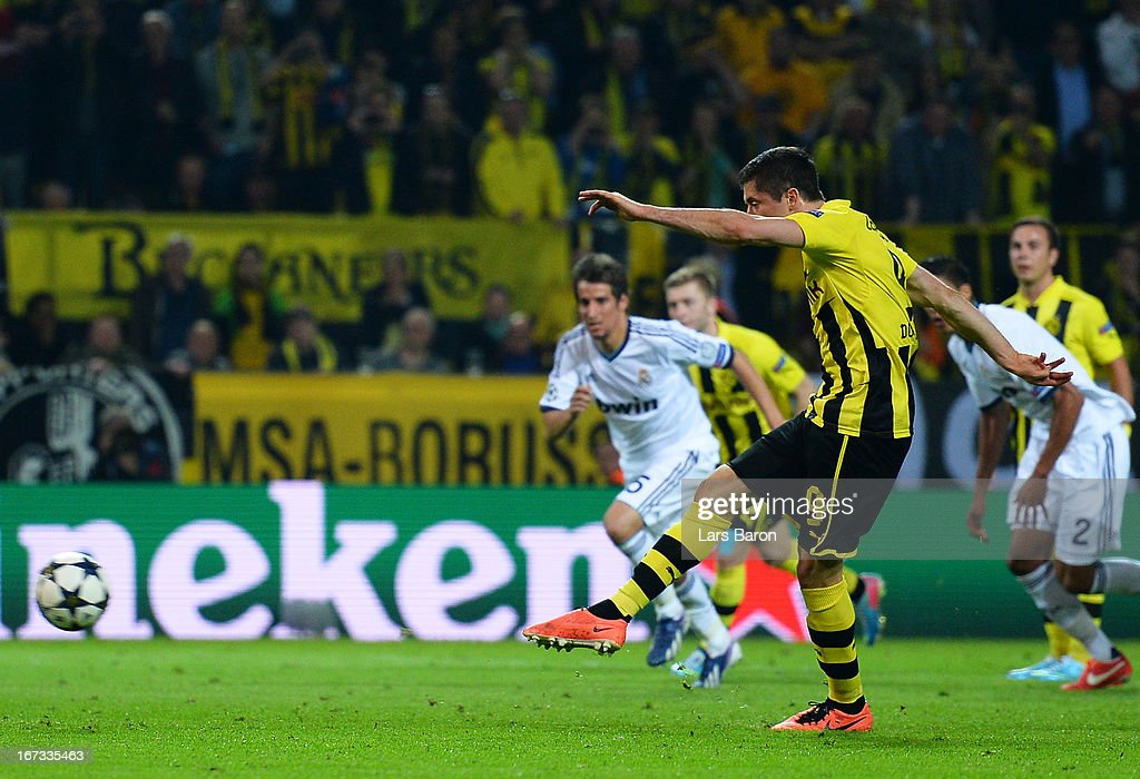 Robert Lewandowski of Borussia Dortmund scores his team's fourth goal from the penalty spot during the UEFA Champions League semi final first leg match between Borussia Dortmund and Real Madrid at Signal Iduna Park on April 24, 2013 in Dortmund, Germany.