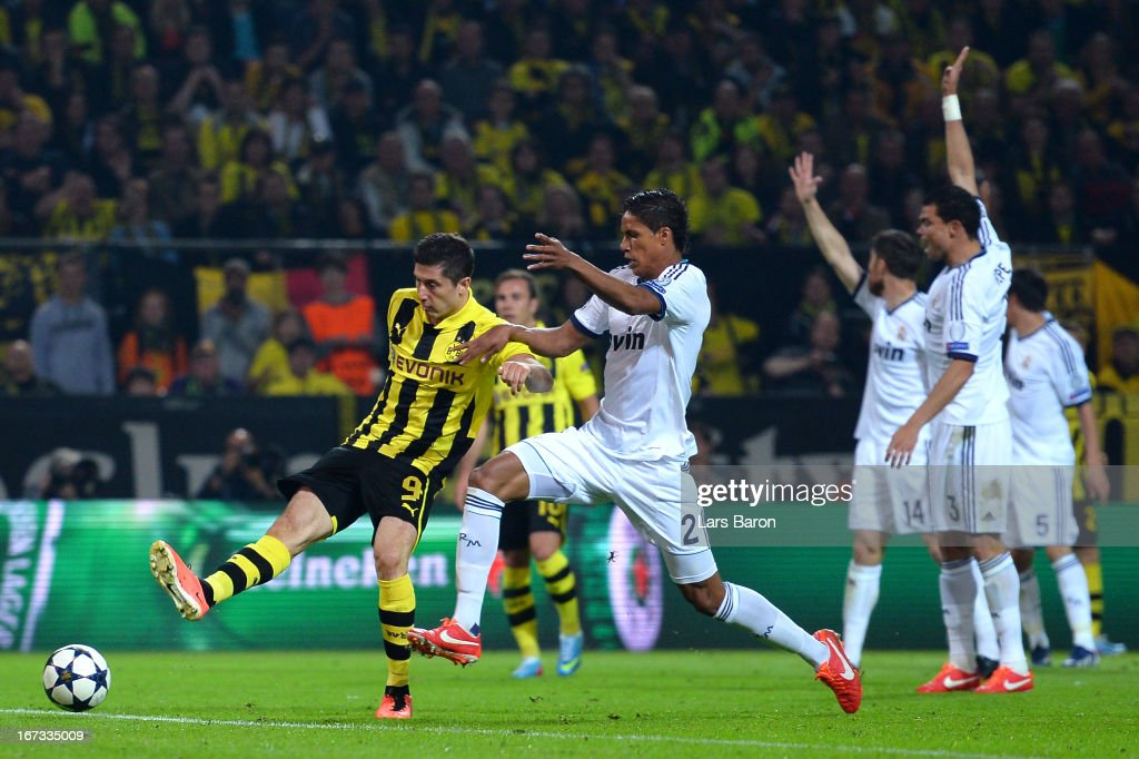 <a gi-track='captionPersonalityLinkClicked' href=/galleries/search?phrase=Robert+Lewandowski&family=editorial&specificpeople=5532633 ng-click='$event.stopPropagation()'>Robert Lewandowski</a> of Borussia Dortmund scores his team's second goal as Real Madrid players appeal for offside during the UEFA Champions League semi final first leg match between Borussia Dortmund and Real Madrid at Signal Iduna Park on April 24, 2013 in Dortmund, Germany.