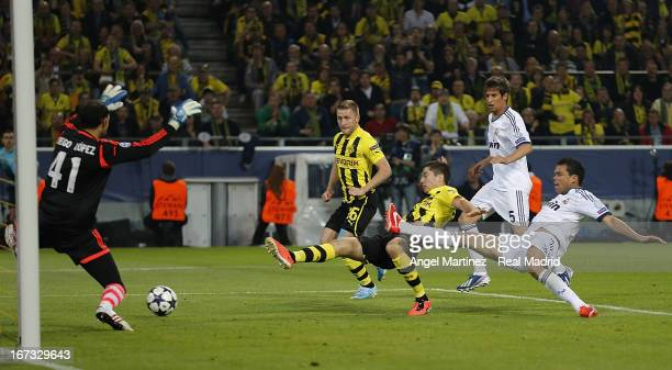 Robert Lewandowski of Borussia Dortmund scores the opening goal past goalkeeper Diego Lopez of Real Madrid during the UEFA Champions League Semi...