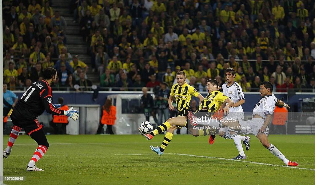 Robert Lewandowski of Borussia Dortmund scores the opening goal past goalkeeper Diego Lopez of Real Madrid during the UEFA Champions League Semi Final first leg match between Borussia Dortmund and Real Madrid at Signal Iduna Park on April 24, 2013 in Dortmund, Germany.