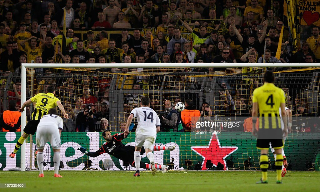 Robert Lewandowski of Borussia Dortmund scores their fourth goal from the penalty spot during the UEFA Champions League semi final first leg match between Borussia Dortmund and Real Madrid at Signal Iduna Park on April 24, 2013 in Dortmund, Germany.